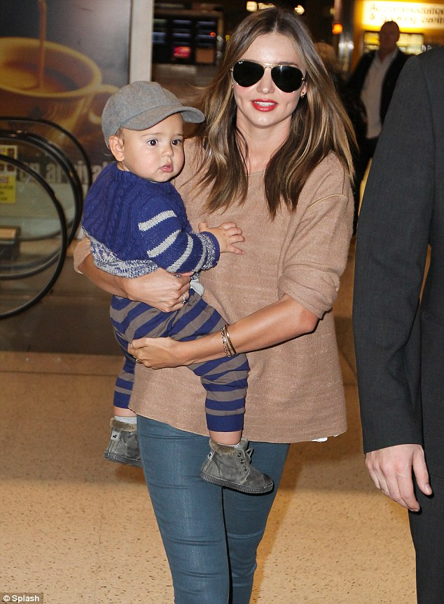 Hot model Miranda Kerr and baby Flynn land in Sydney Airport
