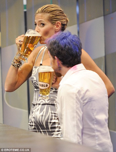 Heidi Klum shows her beer guzzling skills on Spanish TV