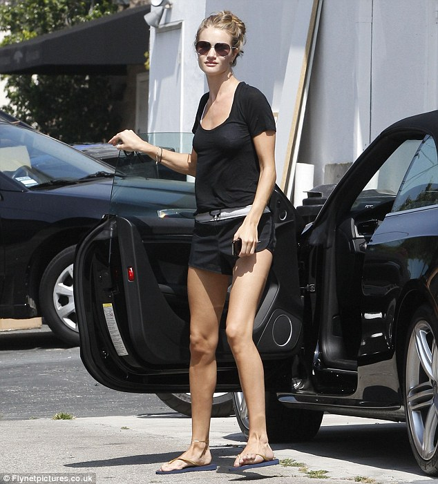 Rosie Huntington-Whiteley shows off glam legs in short shorts at gym