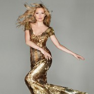 Supermodel Kate Moss goes for gold in Steve McQueen dress