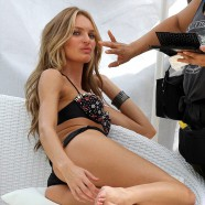 Candice Swanepoel makes a splash in skimpy swimwear and turns up the heat