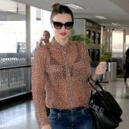 Miranda Kerr puts her bra on display at airport