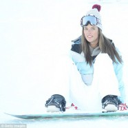 Alessandra Ambrosio tries out her snow bunny wings!