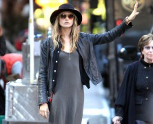 Behati Prinsloo hails a cab in New York City