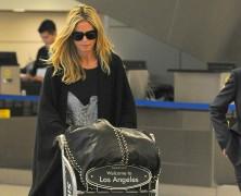 Heidi Klum arrives at LAX looking supermodel perfect!