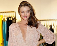 Miranda Kerr smolders in low cut frock at Zimmermann store launch
