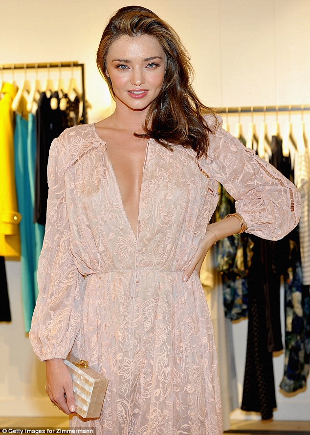 Miranda Kerr smolders in low cut frock at Zimmermann store launch