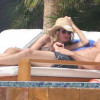 Gisele Bundchen lets the sun kiss her